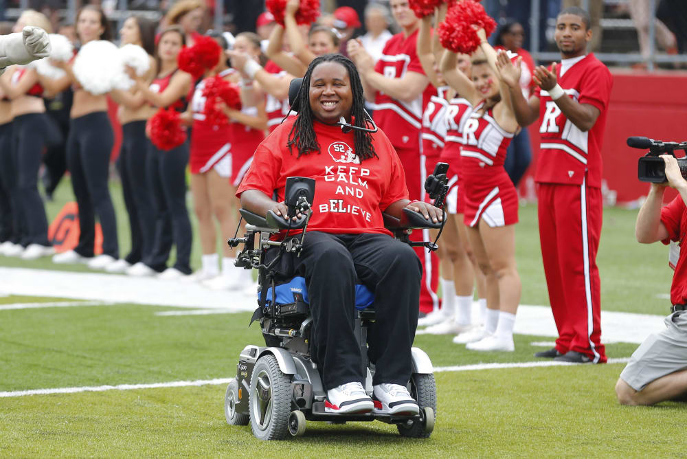 Sep 14, 2013; Piscataway, NJ, USA;  Rutgers Scarlet Knights former player Eric LeGrand enters High Points Solutions Stadium during halftime of a game against the Eastern Michigan Eagles for his jersey number retirement ceremony. Mandatory Credit: Jim O'Connor-USA TODAY Sports