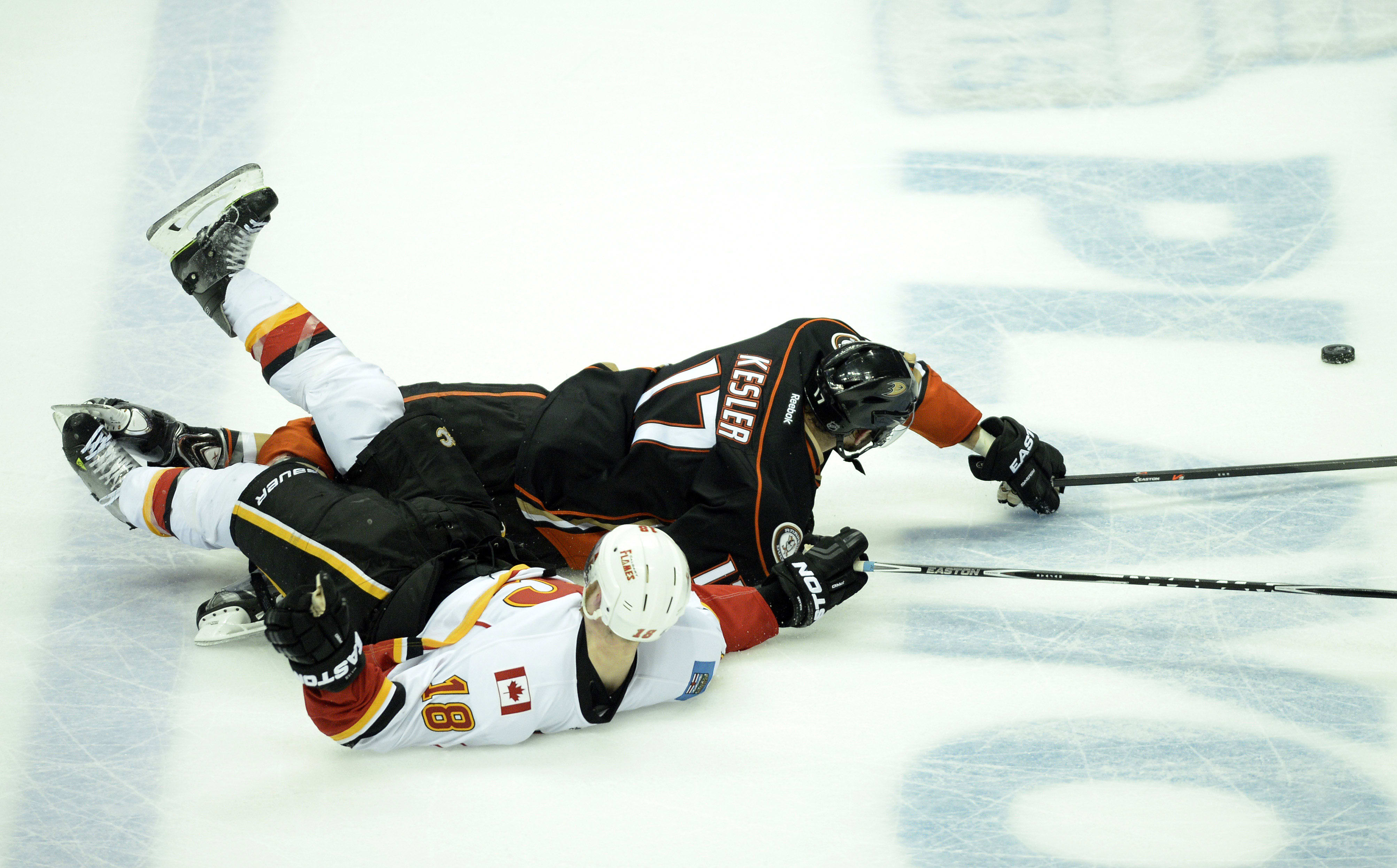 May 10, 2015; Anaheim, CA, USA; Anaheim Ducks center Ryan Kesler (17) and Calgary Flames center Matt Stajan (18) battle for the puck during the third period in game five of the second round of the 2015 Stanley Cup Playoffs at Honda Center. Mandatory Credit: Kelvin Kuo-USA TODAY Sports