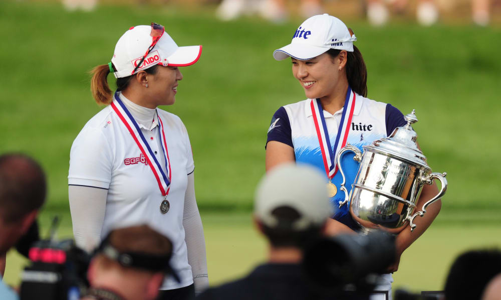 Jul 12, 2015; Lancaster, PA, USA; Amy Yang and In Gee Chun smile during the award ceremony after the final round of the U.S. Women's Open at Lancaster Country Club. Mandatory Credit: Evan Habeeb-USA TODAY Sports