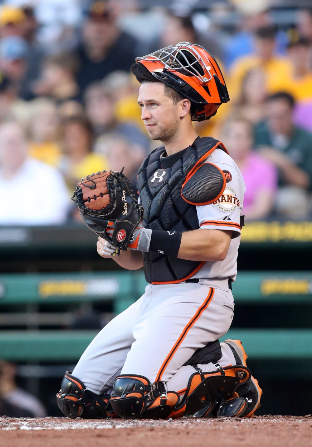 Aug 20, 2015; Pittsburgh, PA, USA; San Francisco Giants catcher Buster Posey (28) kneels behind home plate against the Pittsburgh Pirates during the first inning at PNC Park. Mandatory Credit: Charles LeClaire-USA TODAY Sports