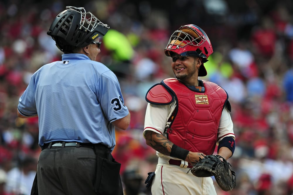 Sep 5, 2015; St. Louis, MO, USA; St. Louis Cardinals catcher Yadier Molina (4) talks with umpire Gary Cederstrom (38) during the seventh inning against the Pittsburgh Pirates at Busch Stadium. The Cardinals defeated the Pirates 4-1. Mandatory Credit: Jeff Curry-USA TODAY Sports